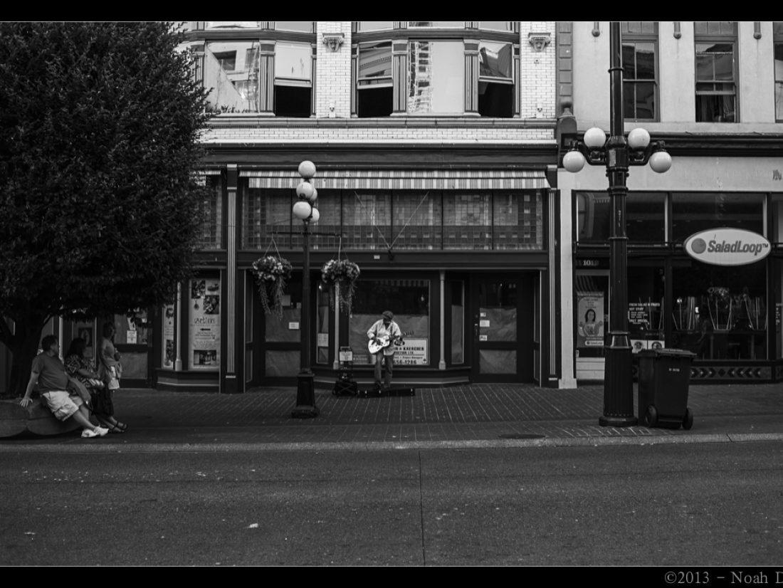 Street scene: a busker…